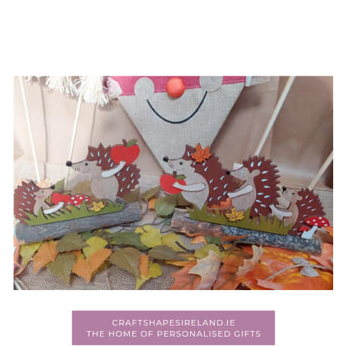 Hedgehogs with apples on Branch